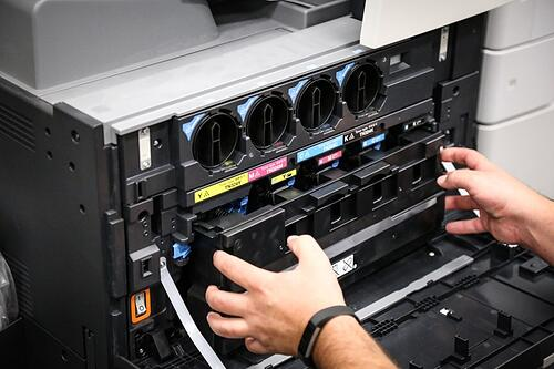 Man replacing toner cartridge