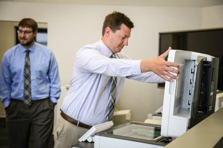 Man opens copier