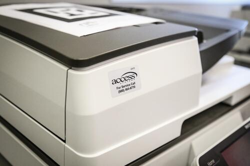 Access Systems tag on a copier