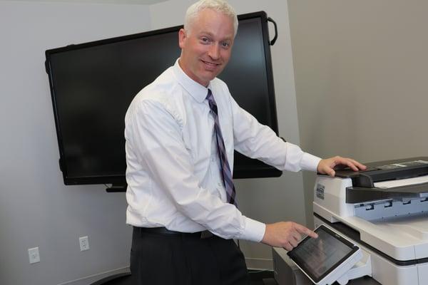 A man using his copier machine