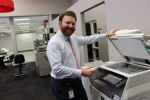 Man scanning a paper
